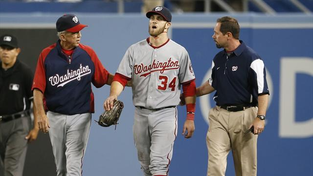 Baseball - Harper leaves game after painful wall collision