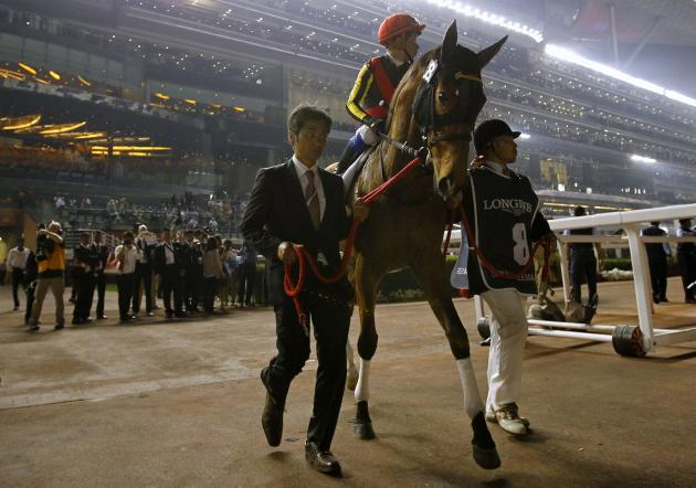 "Iwata, riding Gentildonna of Japan, enters the racecourse ahead of the eighth race ""Dubai Sheema Classic"" during the Dubai World Cup at the Meydan Racecourse in Dubai"