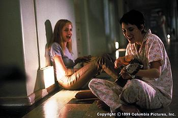 After friend and fellow patient Polly lands herself in solitary, Lisa ( Angelina Jolie , left) and Susanna ( Winona Ryder ) serenade her in Columbia Pictures' GIRL, INTERRUPTED (12/99).