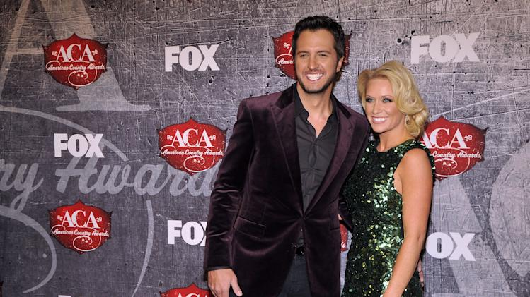 From left, singer Luke Bryan and Caroline Boyer arrive at the American Country Awards on Monday, Dec. 10, 2012, in Las Vegas. (Photo by Jeff Bottari/Invision/AP)