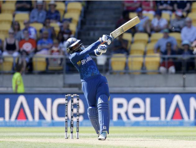 Sri Lanka's Tillakaratne Dilshan plays a shot off the bowling of England's Stuart Broad during their Cricket World Cup match in Wellington