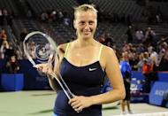 Petra Kvitova of the Czech Republic poses with the winner's trophy after defeating Li Na of China in the single's final of the Rogers Cup on August 13. Kvitova remains committed to joining the women's elite with the quiet Czech hoping to follow up Monday's title in Canada at the ATP-WTA Cincinnati Masters