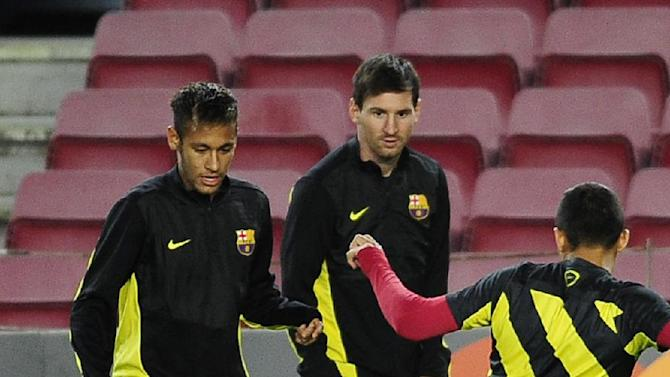 FC Barcelona Neymar, from Brazil, left, and Lionel Messi, from Argentina, second left, attend a training session at the Camp Nou in Barcelona, Spain, Tuesday, Nov. 5, 2013.  FC Barcelona will play against AC Milan in a group H Champions League soccer match on Wednesday Nov. 6