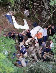 Montenegran rescue workers at the scene of a bus accident near Grlo, on June 23, 2013. At least 18 Romanians perished when their bus plunged into a ravine in Montenegro, in one of the deadliest road accidents in the tiny Adriatic republic