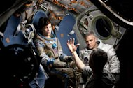 "Sandra Bullock, George Clooney and director Alfonso Cuarón on the set of the dramatic thriller ""Gravity."""