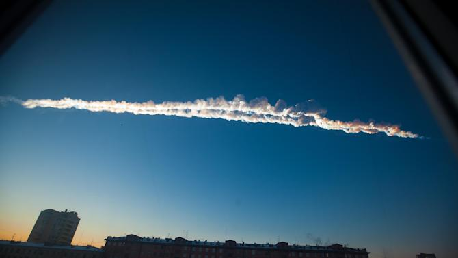 In this photo provided by Chelyabinsk.ru a meteorite contrail is seen over Chelyabinsk on Friday, Feb. 15, 2013. A meteor streaked across the sky of Russia's Ural Mountains on Friday morning, causing sharp explosions and reportedly injuring around 100 people, including many hurt by broken glass. (AP Photo/Chelyabinsk.ru)