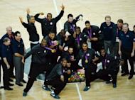 US players pose with their gold medals after winning the London 2012 Olympic Games men's basketball competition at the North Greenwich Arena in London