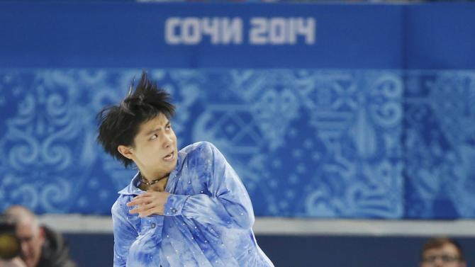 Yuzuru Hanyu during his figure skating team men's short program at the Sochi 2014 Winter Olympics