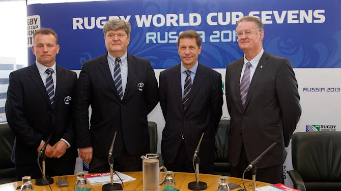 (From left) Kingsley Jones, National Teams Director, Vyacheslav Kopiev, President of the Rugby Union Russia, Alexander Zhukov, Deputy President of Russia and Bernard Lappasset, Chairman of the IRB, pose during a Rugby Sevens announcement at the TSB Center in New Plymouth on September 15, 2011. It has been announced that the 2013 IRB Rugby Sevens Tournament will be held in the Russian city of Mosscow. AFP PHOTO / Marty Melville (Photo credit should read Marty Melville/AFP/Getty Images)