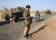 French soldiers guard a military convoy heading toward Gao on February 7, 2013 on the road from Gossi. Nearly a month after France sent in the first fighter jets and attack helicopters, it has largely driven the rebels into remote mountains in the far northeast. But the threat from the rebels is still very real