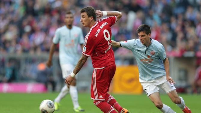 Bayern's Mario Mandzukic of Croatia, left, and Mainz's Christoph Moritz challenge for the ball during the German first division Bundesliga soccer match between FC Bayern Munich and FSV Mainz 05, in Munich, southern Germany, Saturday, Oct. 19, 2013
