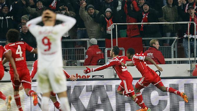 Bayern's Thiago Alcantara of Spain, center, celebrates his side's winning goal during a German first soccer division Bundesliga match between VfB Stuttgart and FC Bayern Munich in Stuttgart, Germany, Wednesday, Jan. 29, 2014