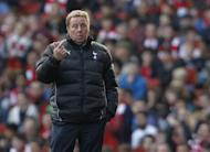 Manager of Tottenham Hotspur Harry Redknapp gestures to players during a match between Arsenal and Hotspur in London in February 2012. Redknapp appeared set for a dramatic exit as the manager of Tottenham Hotspur, reports said with the BBC quoting sources saying he has already left White Hart Lane