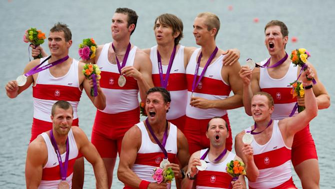 Canada's men's eight rowing team members celebrate their silver medal at Eton Dorney during the 2012 Summer Olympics in Dorney, England on Wednesday, August 1, 2012. THE CANADIAN PRESS/Sean Kilpatrick
