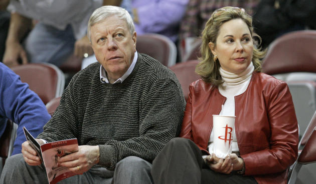 In this photo taken Nov. 16, 2006, Richard D. Kinder, left, and his wife Nancy attend a Houston Rockets NBA basketball game in Houston. A dozen million-dollar contributors account for at least 10 perc