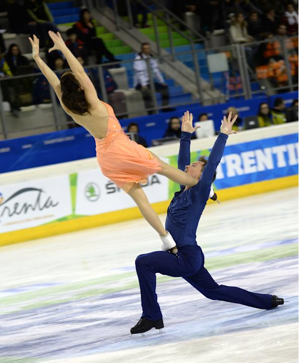 TRENTINO, Dec. 15, 2013 (Xinhua/IANS) -- Zlobina Julia (L) and Sitnikov Alexei of Azerbaijan perform during the ice dance of figure skating event at the 2013 Winter Universiade in Trentino ,Italy on D