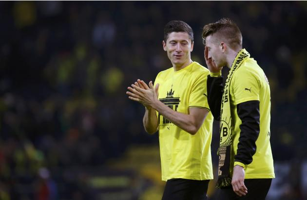 Borussia Dortmund's Lewandowski and Reus celebrate after German soccer cup semi-final match against WfL Wolfsburg in Dortmund