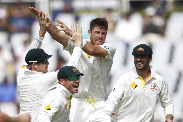 Australia's Pattinson and Smith celebrate the wicket of South Africa's Elgar with Warner and Doolan looking on during the third day of the third test cricket match at Newlands Stadium in Cape