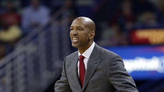 New Orleans Pelicans head coach Monty Williams reacts from the bench in the first half of an NBA basketball game against the Phoenix Suns in New Orleans, Tuesday, Nov. 5, 2013