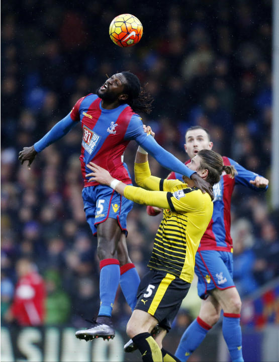 Crystal Palace's Emmanuel Adebayor, top left, battles for the ball with Watford's Sebastian Prodl during the English Premier League soccer match at Selhurst Park, London, Saturday Feb. 13, 201