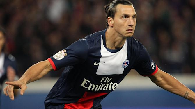 Paris Saint Germain's forward Zlatan Ibrahimovic from Sweden reacts after scoring  a goal, during his French League One soccer match against Monaco, at the Parc des Princes stadium, in Paris, Sunday, Sept. 22, 2013