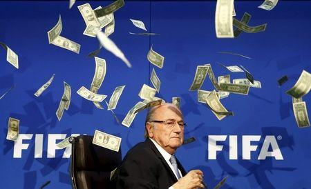 File photos shows banknotes being thrown at FIFA President Blatter as he arrives for a news conference after the Extraordinary FIFA Executive Committee Meeting at the FIFA headquarters in Zurich
