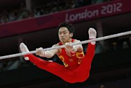 China's Zou Kai during the men's high bar final at the London Olympics on August 7. Zou recorded a strong score of 16.366 points but saw first Fabian Hambuchen of Germany and then the Netherlands' Epke Zonderland better his mark to leave him in third place