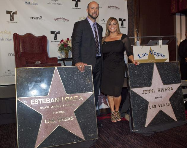 Singer Jenni Rivera, right, and her husband, former Major League Baseball pitcher Esteban Loaiza, pose for a photograph with Las Vegas Walk of Stars presented to them during an official ceremony Frida