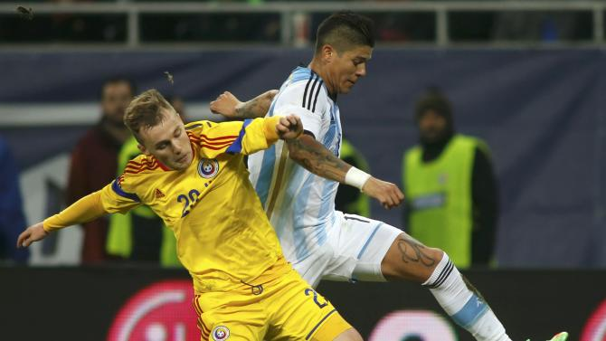 Argentina's Rojo challenges Romania's Maxim during their international friendly soccer match at the National Arena in Bucharest