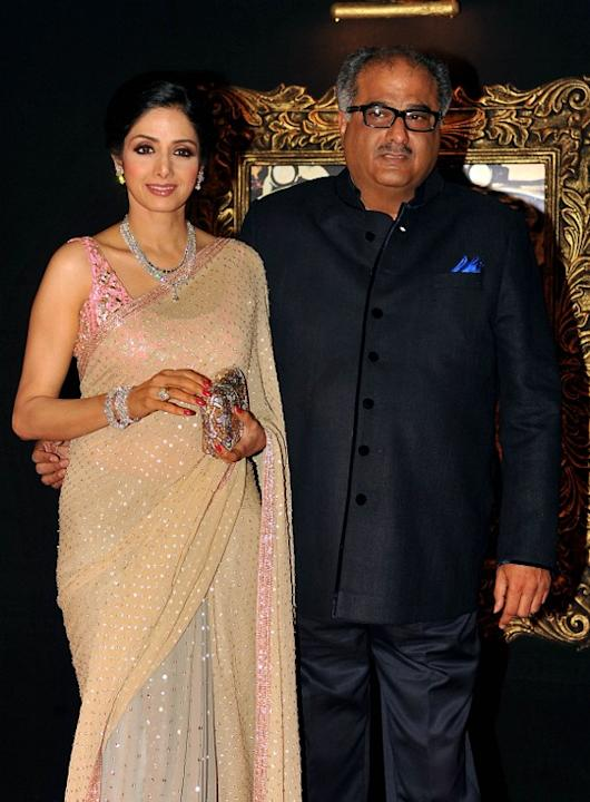 Indian Bollywood film actress Shridevi (L) and her husband Boney Kapoor pose on the red carpet at the premiere of the Hindi film 'Jab Tak Hai Jaan' in Mumbai on November 12, 2012.   AFP PHOTO