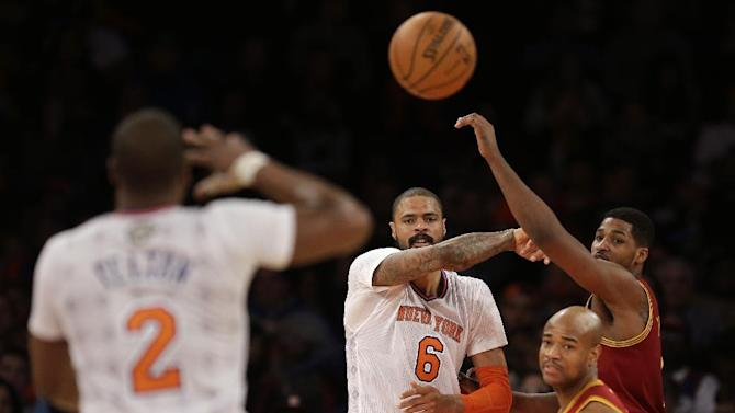 New York Knicks' Tyson Chandler (6), second form left, passes the ball during the second half of the NBA basketball game against the Cleveland Cavaliers at Madison Square Garden, Sunday, March 23, 2014, in New York. The Cavaliers defeated the Knicks 106 to 100