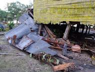 "This photo, taken on February 7, 2013, by World Vision, shows damage to a house in the village of Louva, caused by a tsunami in the Santa Cruz Islands region of the Solomons Islands. Relief workers scrambled to reach quake-ravaged villages in the Solomons on Saturday, with ""unusual seismic activity"" sighted as strong aftershocks continued to jolt the remote Pacific region"