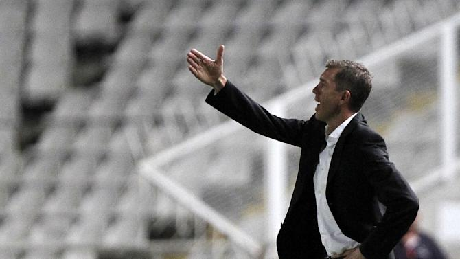 Slovenia coach Srecko Kataec gestures to his players during their World Cup group E qualifying soccer match at GSP stadium in Nicosia, Cyprus, Tuesday, Sept. 10, 2013