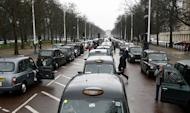British Taxi black cab drivers protest by parking along The Mall in central London on February 5, 2009. Geely said Friday it had acquired the maker of London's iconic black taxis for 11.04 million pounds ($17.50 million) after the British company collapsed into administration