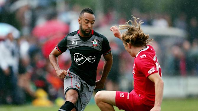 Southampton's Nathan Redmond and FC Twente's Jeroen Van Der Lely in action