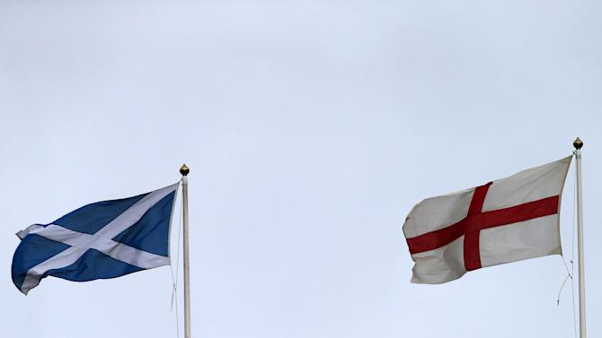 A general view of a Scottish Saltire flag, and England's St Georges cross flying ahead of the Six Nations rugby union international match between Scotland and England at Murrayfield, Edinburgh, Scotland, Saturday Feb. 8, 2014