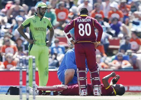 West Indies batsman Darren Bravo lies on the ground, after injuring himself a second time, during their Cricket World Cup match against Pakistan in Christchurch