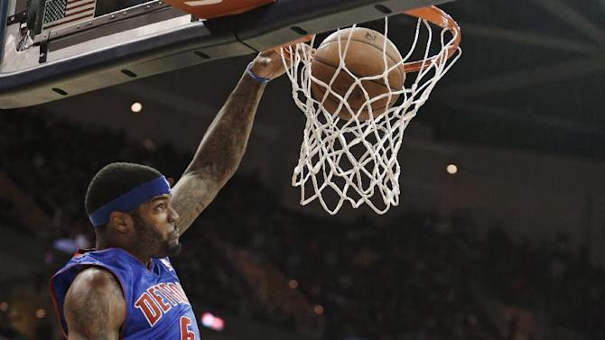 Detroit Pistons' Josh Smith, left, dunks on Cleveland Cavaliers' Earl Clark during the first quarter of an NBA basketball game Monday, Dec. 23, 2013, in Cleveland