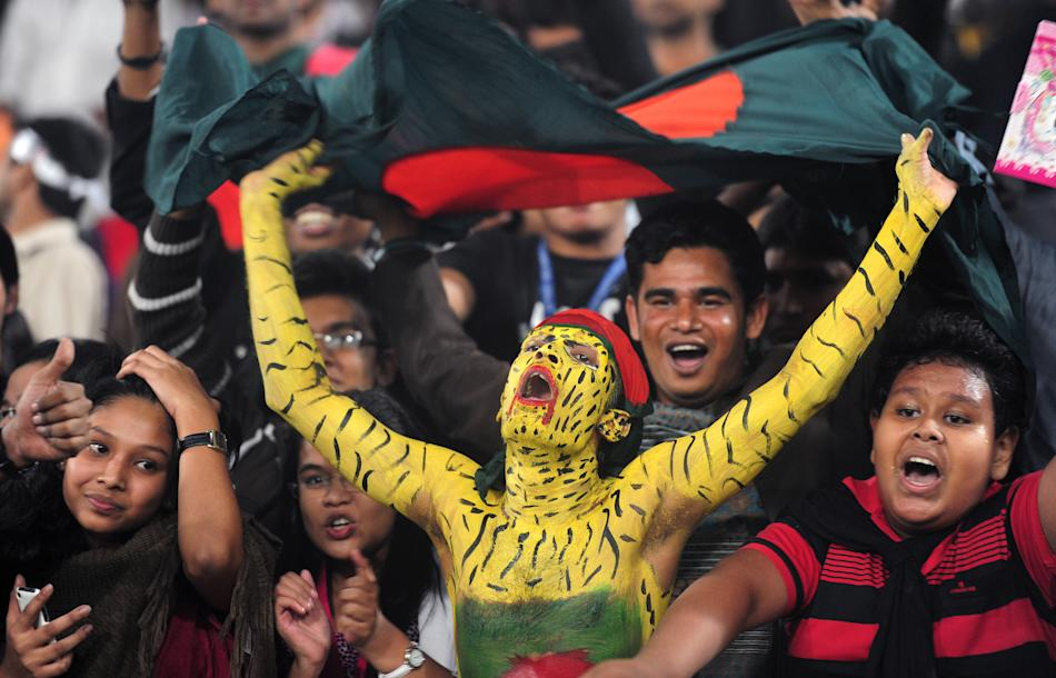 Bangladeshi cricket spectators celebrate as the Bangladesh cricket team won the series during the fifth one day international between Bangladesh and West Indies at The Sher-e-Bangla National Cricket S