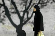 An elderly woman is pictured in Beijing, on November 26, 2012. China has passed a new law stipulating that family members should pay regular visits to their elderly relatives, according to the government's official website