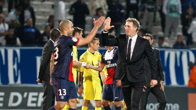 Paris Saint Germain's French coach Laurent Blanc, right,  celebrate with Paris Saint Germain's Brazilian defender Alex, after defeating Marseille, during their League One soccer match, at the Velodrome Stadium, in Marseille, southern France, Sunday, Oct. 6, 2013