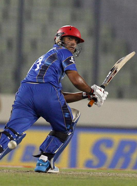 Afghanistan's Najibullah Zadran watches his shot during their Asia Cup one-day international cricket match against Sri Lanka in Dhaka, Bangladesh, Monday, March 3, 2014. Sri Lanka won the match by 129