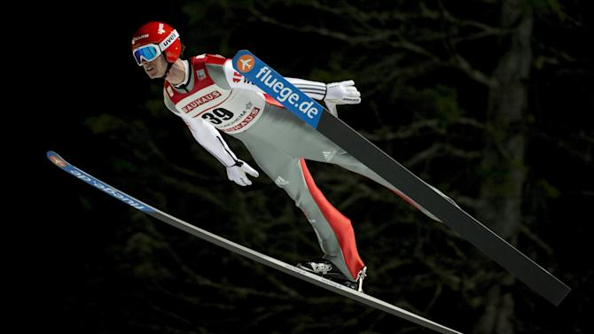 Andreas Wank of Germany soars in the air during training and qualification for the FIS Ski Jumping World Cup competition in Trondheim