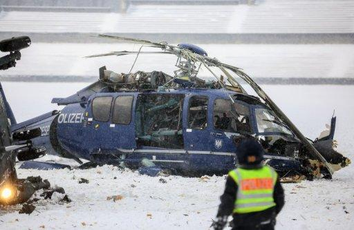 German police inspect the scene after two helicopters crashed near the Olympic stadium in Berlin, on March 21, 2103