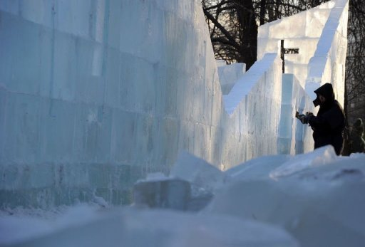 A sculptor works on a wall of the ice fortress in a park in central Moscow on December 23, 2012. A deadly cold snap has claimed 88 lives across Russia, officials said Sunday, as Moscow authorities told schoolchildren they could stay home to avoid the frigid temperatures.