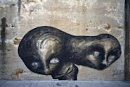 In this Feb. 12, 2017 photo, the work of urban artist Yulier P. adorns a wall on a street in Havana, Cuba. The works of the 27-year-old artist, whose full name is Yulier Rodríguez Pérez, are striking not just for their artistry and ubiquity, but the fact that they exist at all in a place where graffiti is rare. (AP Photo/Ramon Espinosa)