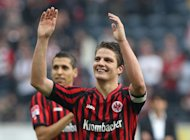 Frankfurt's Pirmin Schwegler celebrates their 3-1 victory after the German first division Bundesliga match Eintracht Frankfurt vs Hanover 96 in the central German city of Frankfurt am Main, on October 20. Second-placed Frankfurt continue to be the Bundesliga's dark horses with six wins in their eight games and on Sunday they are at resurgent Stuttgart