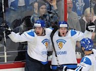 Finnish players celebrate after scoring during the International Ice Hockey World Championship quarter-final against the US on May 17. Finland will take on neighbours Russia in the first semi-final at the Hartwall arena in Helsinki on Saturday
