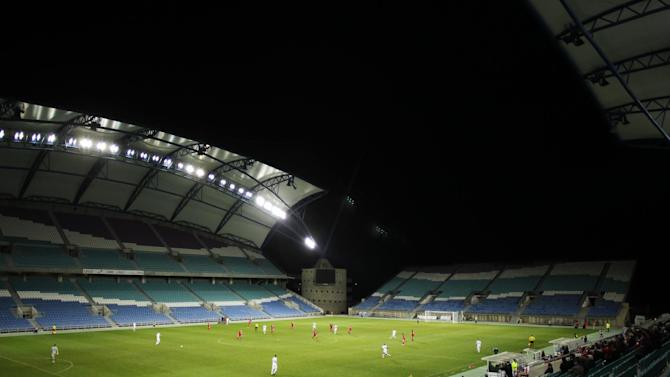 Gibraltar, red, plays against Slovakia, white, in a friendly soccer match at the Algarve stadium in Faro, southern Portugal, Tuesday, Nov. 19, 2013. Gibraltar played its first international soccer match as a new full member of the UEFA after they were accepted in May. The match ended in a 0-0 draw