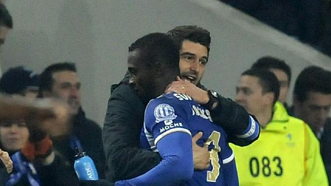 FC Porto's Jackson Martinez, from Colombia, celebrates with his coach Paulo Fonseca after scoring his second goal against Sporting Braga in a Portuguese League soccer match at the Dragao Stadium in Porto, Portugal, Saturday, Dec. 7, 2013. Jackson scored twice in Porto's 2-0 victory
